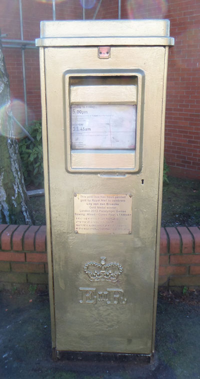 Gold postbox in Divinity Road
